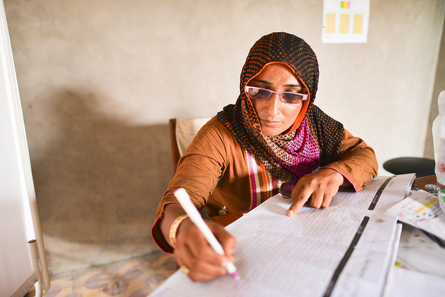 Community midwife filling out paperwork in Tharparkar District, Sindh, Pakistan