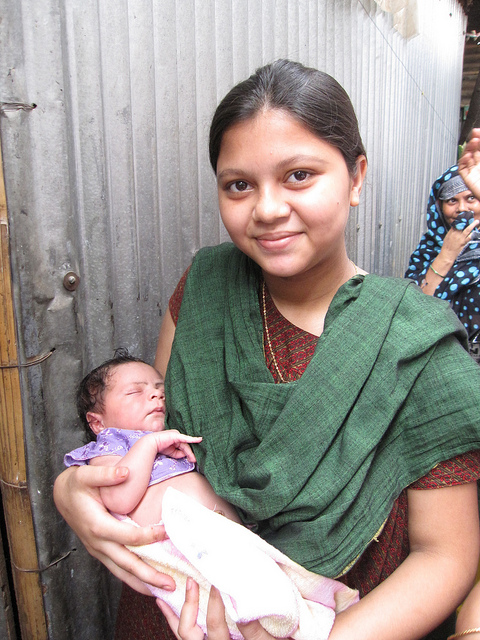 Mother and baby in Dhaka slums, India