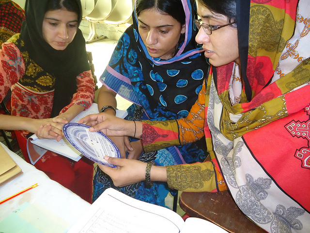 Women in Pakistan using a partograph to build their skills as skilled birth attendants
