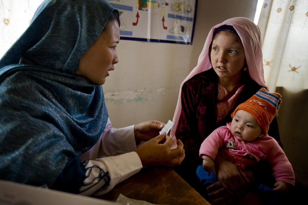 A community midiwife talks to a young mother of three about family planning at a community health center in Bamyan, Afghanistan.