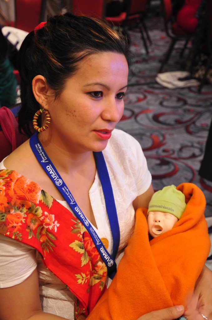 HBS Dhaka workshop attendee with an educational mannequin.