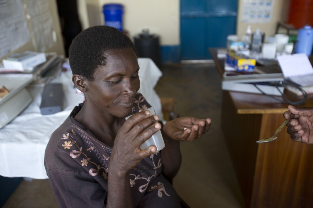 A pregnant woman receives malaria prevention medicine at a clinic in western Kenya
