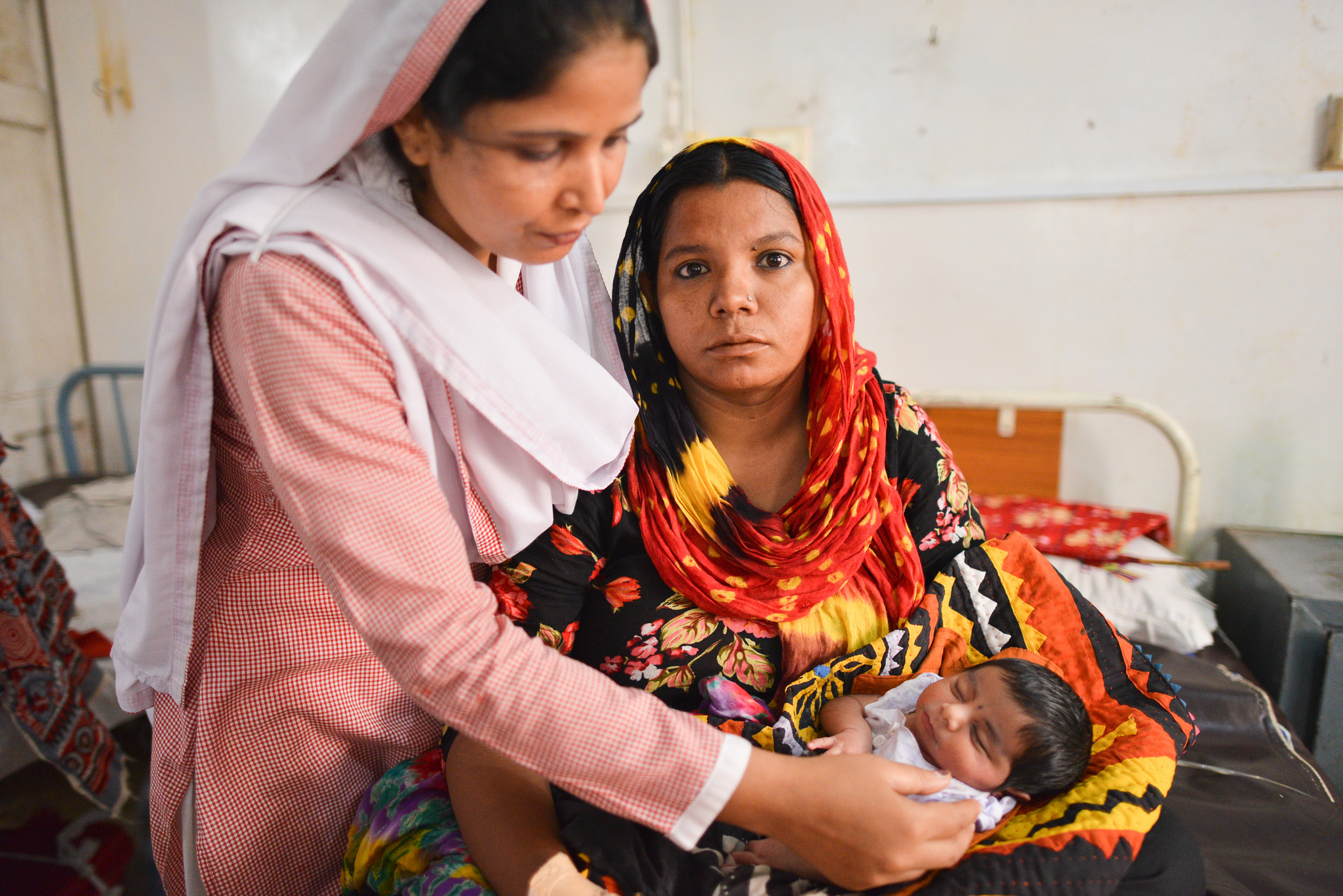 Woman holding newborn in Pakistan