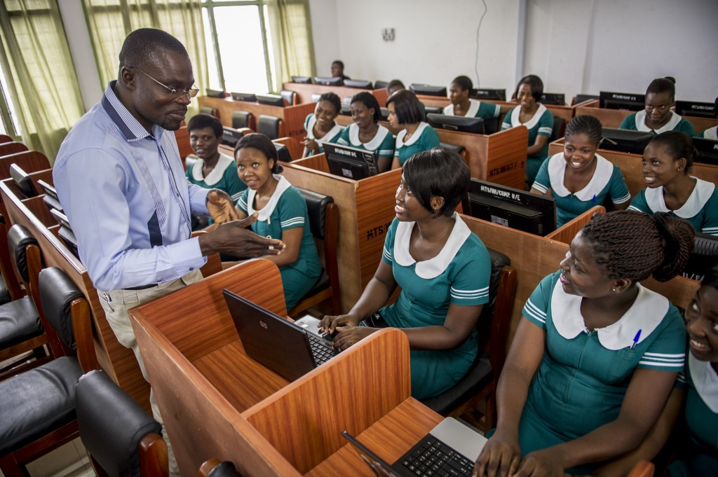 IT tutor instructing students on the use of eLearning at Hohoe Midwifery Training School in Ghana