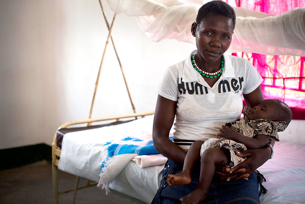 Mother holds her baby in Lanyi Health Centre, in Mundri East County South Sudan