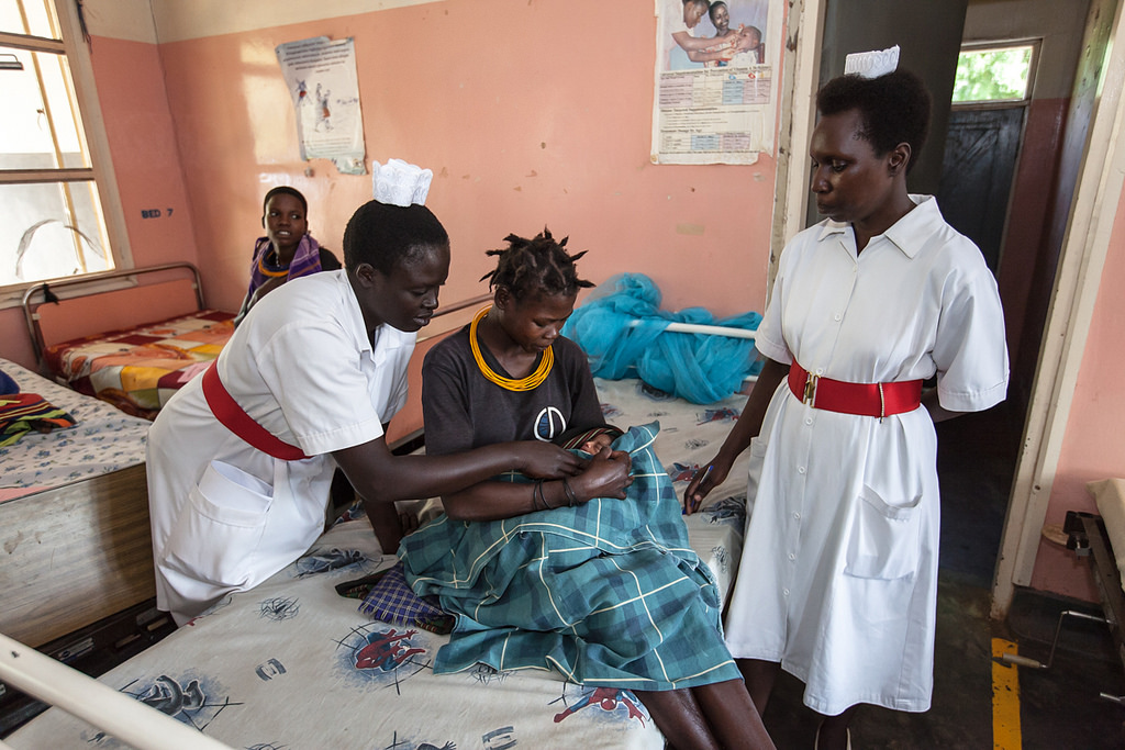 Midwives assist a mother after delivery at Moroto Regional Referral Hospital in Uganda.