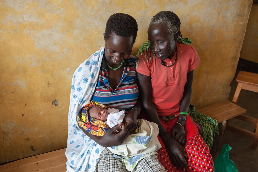 Above: Grandmother and first time mother with newborn in Uganda. (Guido Dingemans/Jhpiego)
