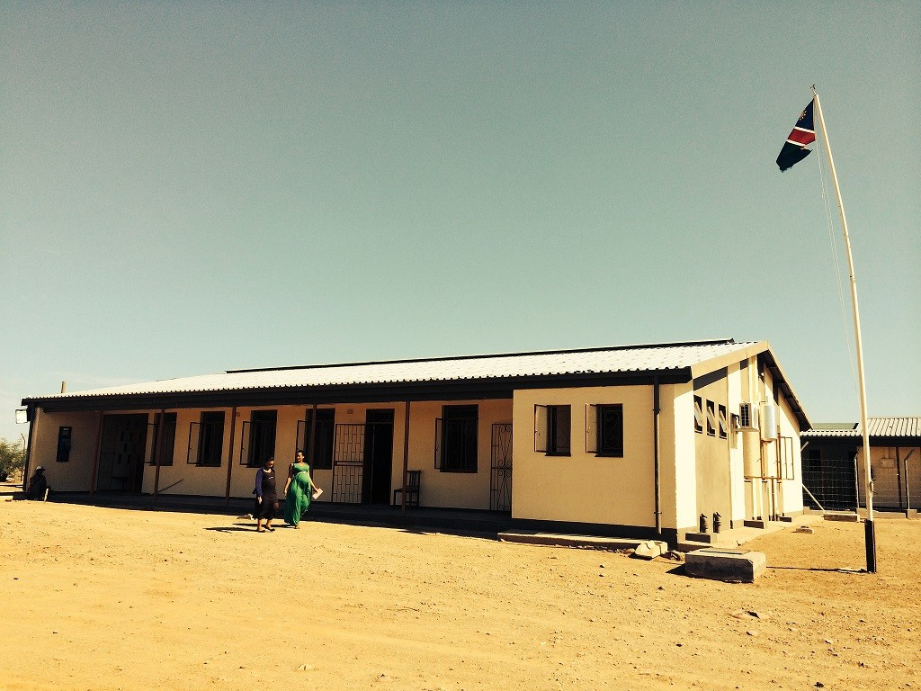 Two women walking outside a rural health facility in Namibia
