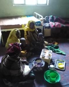 Coffee ceremony in the postnatal room of Karamile Health Center.