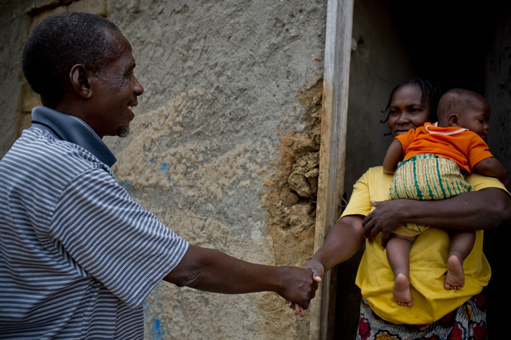 Virginia Maria, a mother of eight, is visited by Aiuba, a community health worker, in Nampula, Mozambique.