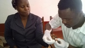 Nurse Marwa draws blood from a fellow participant during MCSP's training
