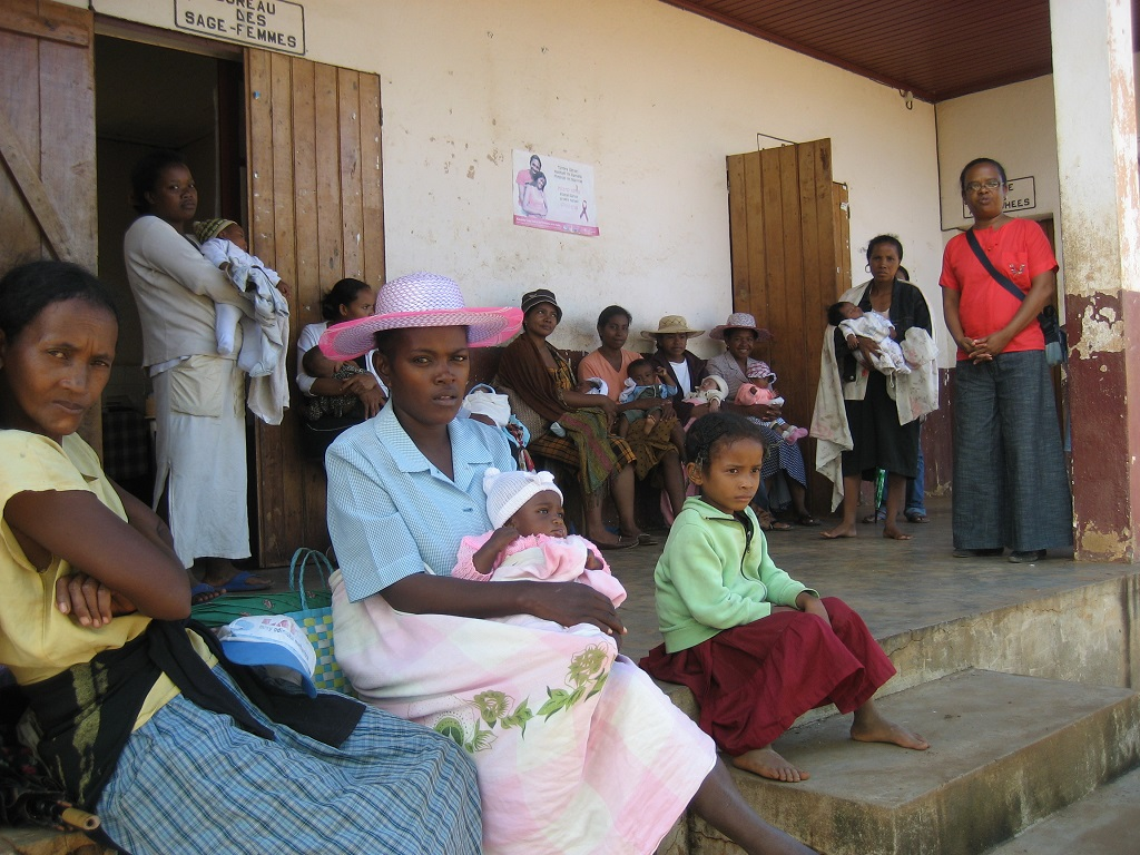Mothers waiting for postnatal care at a clinic in Madagascar