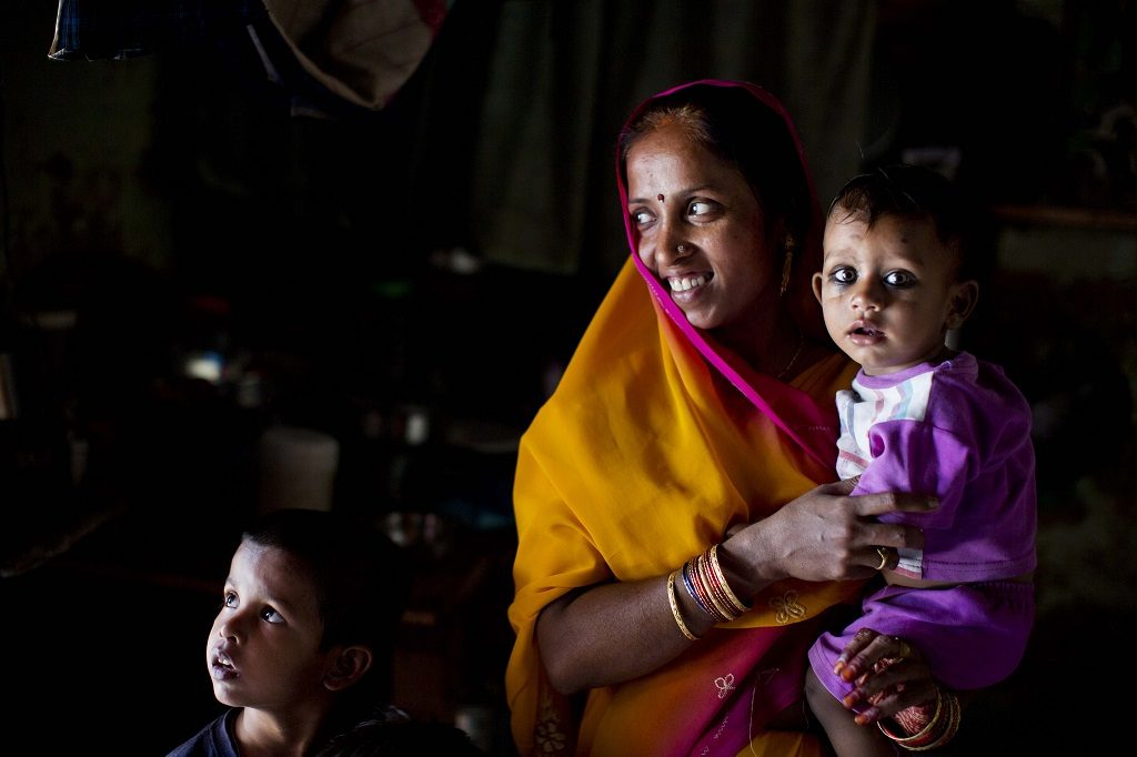 A woman with her children in Allahabad, India