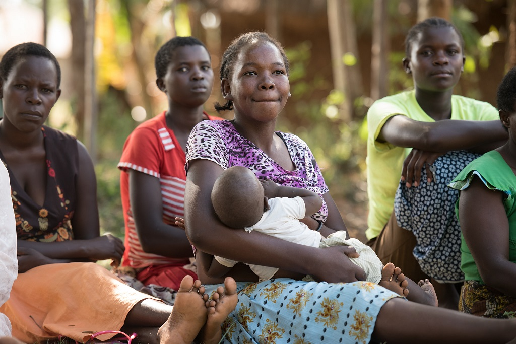 Mothers in Migori, Kenya are reminded of the importance of breastfeeding at a weekly meeting.