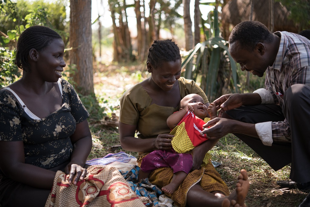 Mothers and a community health worker at a breastfeeding support group in Migori, Kenya.