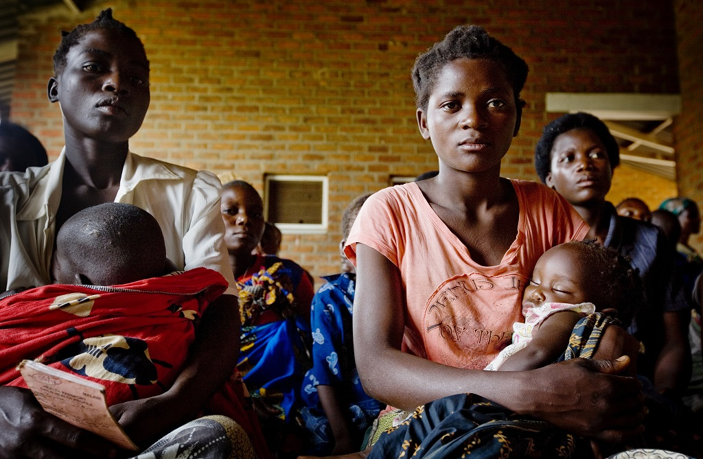 Mothers and children waiting to see a doctor in the village of Kaniche, in the district of Tamwanza, Tanzania