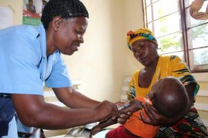 A health provider in Tabora, Tanzania, gives a child an immunization shot.