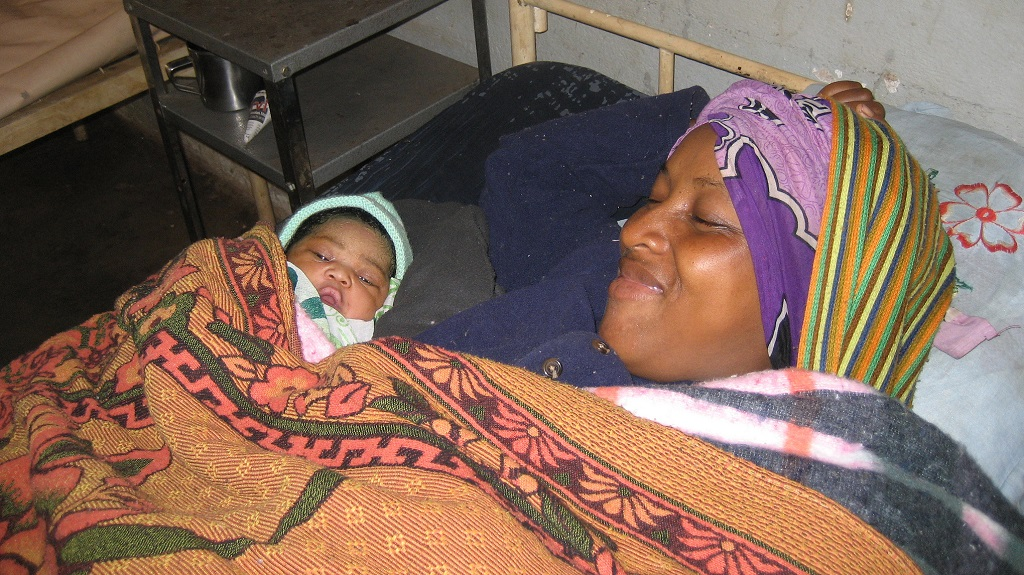 Mother and baby resting after delivery in Madagascar.