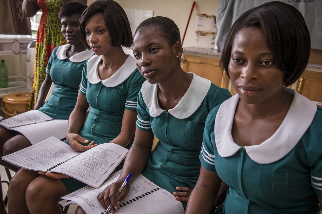 Ghanian midwives watch their instructors do reenactments of women in labor.