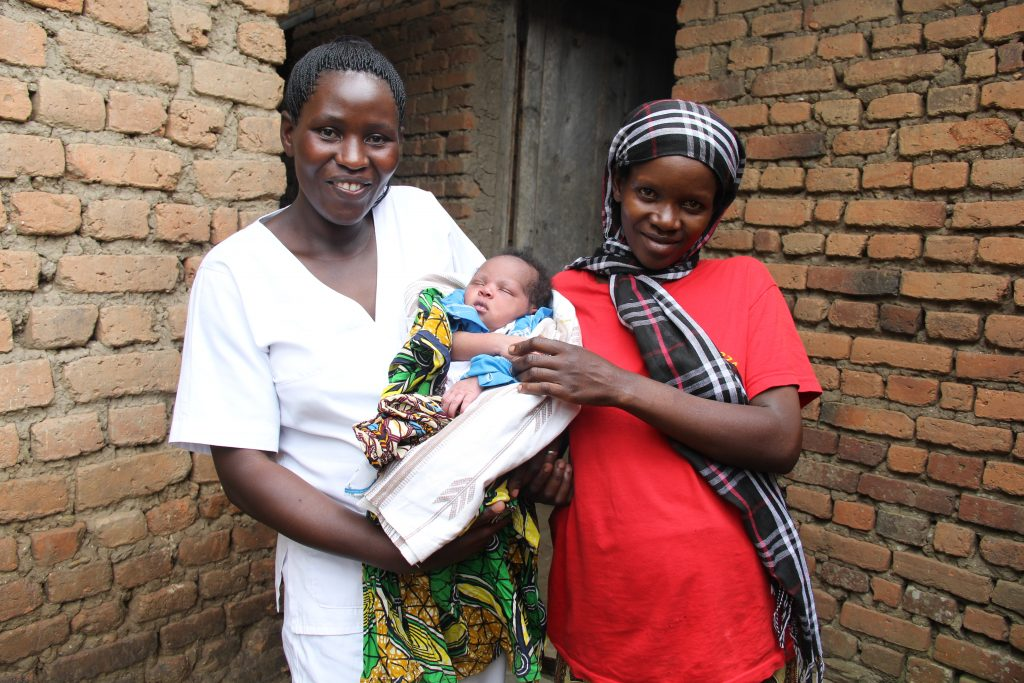 Odette Banzubaze with midwife Agnes Mukampeta who saved her life.