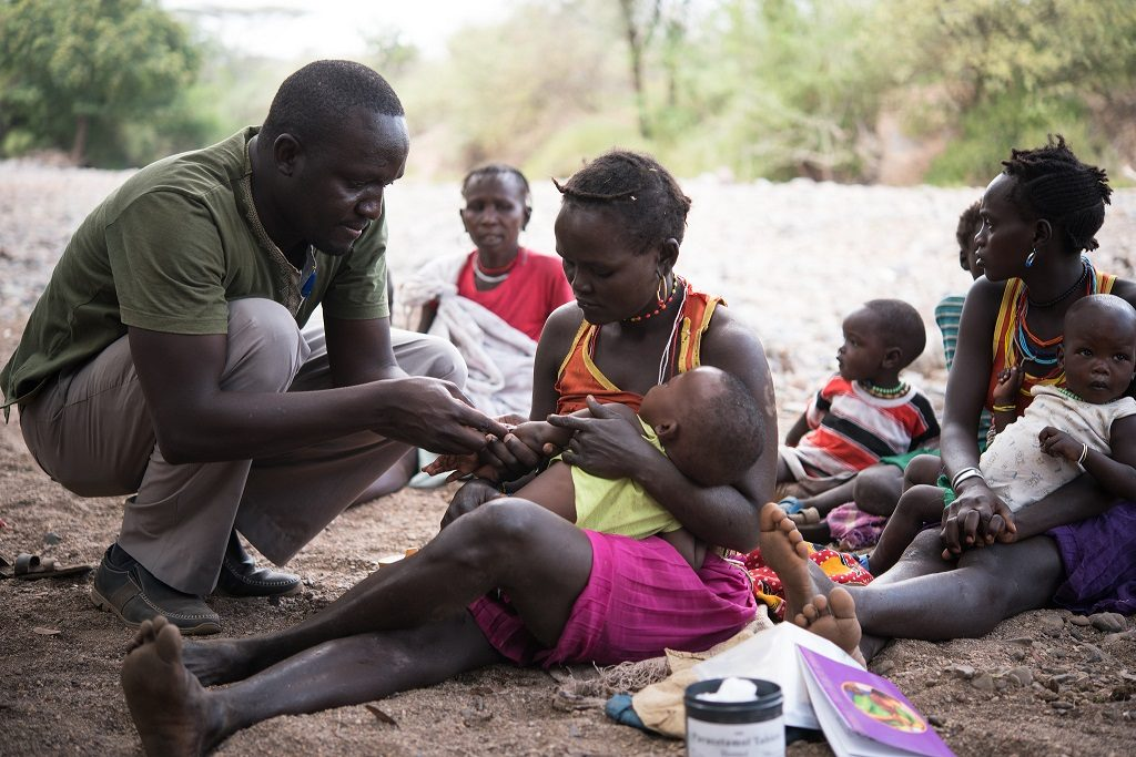 Health worker immunizing a baby during an outreach program in East Pokot, Kenya