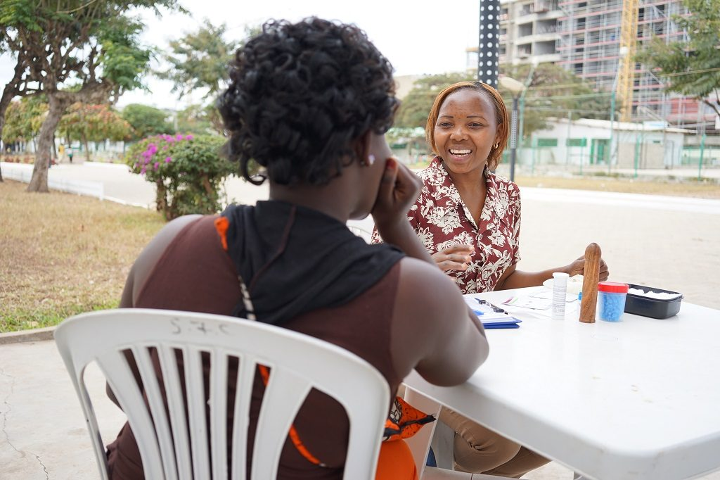 A sex worker in Mozambique receives health information from Zita, a local health counselor.