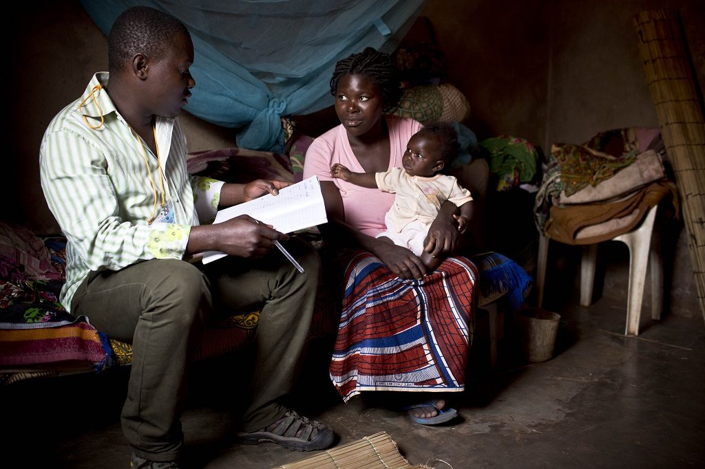 A mother of four is visited by a community health volunteer in her home near Maputo, Mozambique.