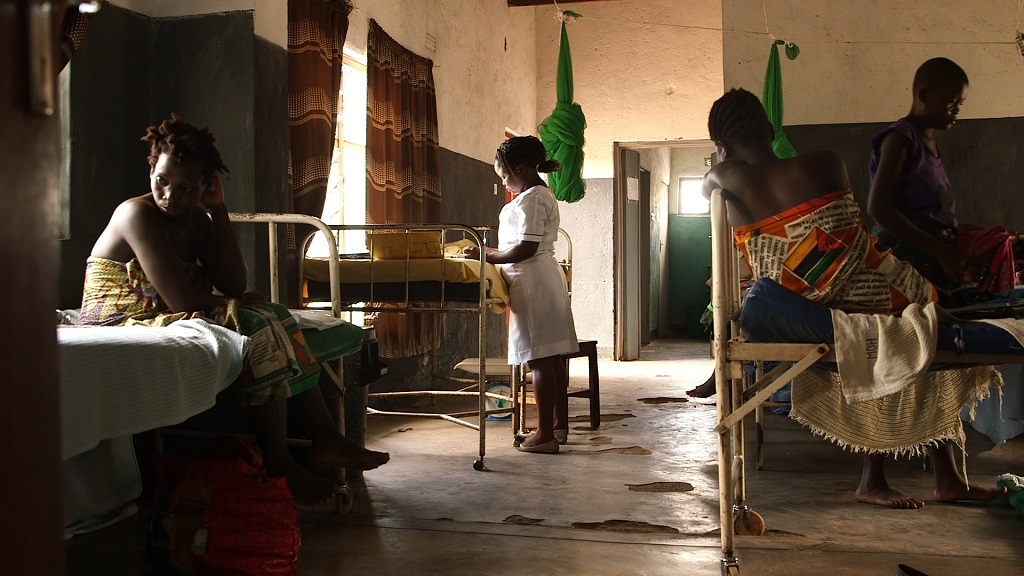A nurse-midwife and patients at Kasinje Health Facility, Malawi.