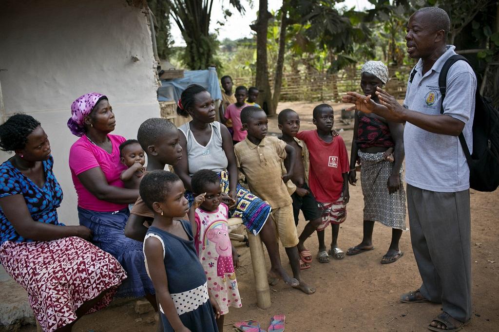 A community health volunteer promoting health messages in Ghana.