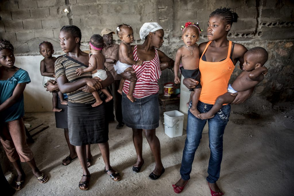 Haitian women in a group holding babies