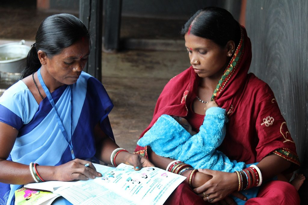 An accredited Social Health Activist in northeastern India discusses the importance of exclusive breastfeeding in the first six months with a new mother.