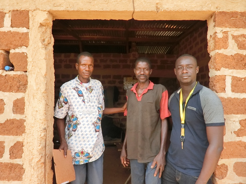 Above: Loukou Kouame with community health workers at his home in Djangokro, Cote d'Ivoire.