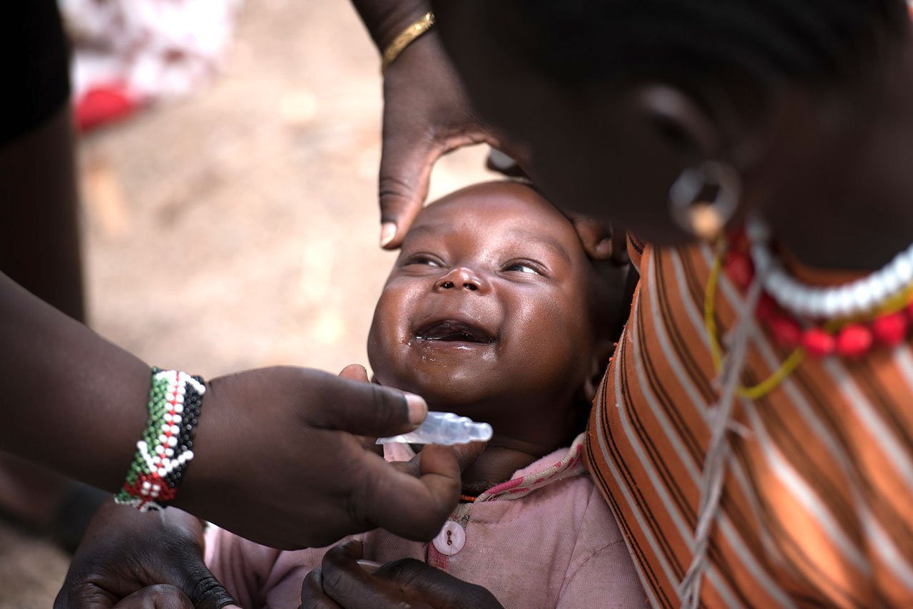 Photo Credit: Allan Gichigi/MCSP Dr. Paul Odila immunizing a baby at an outreach in East Pokot, Kenya