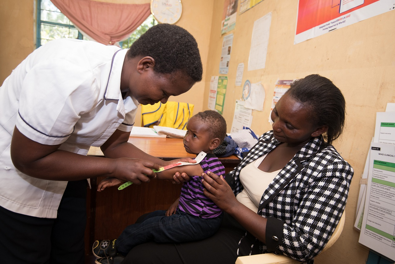 A child is checked by the nurse for malnutrition, Igembe, Meru, Kenya