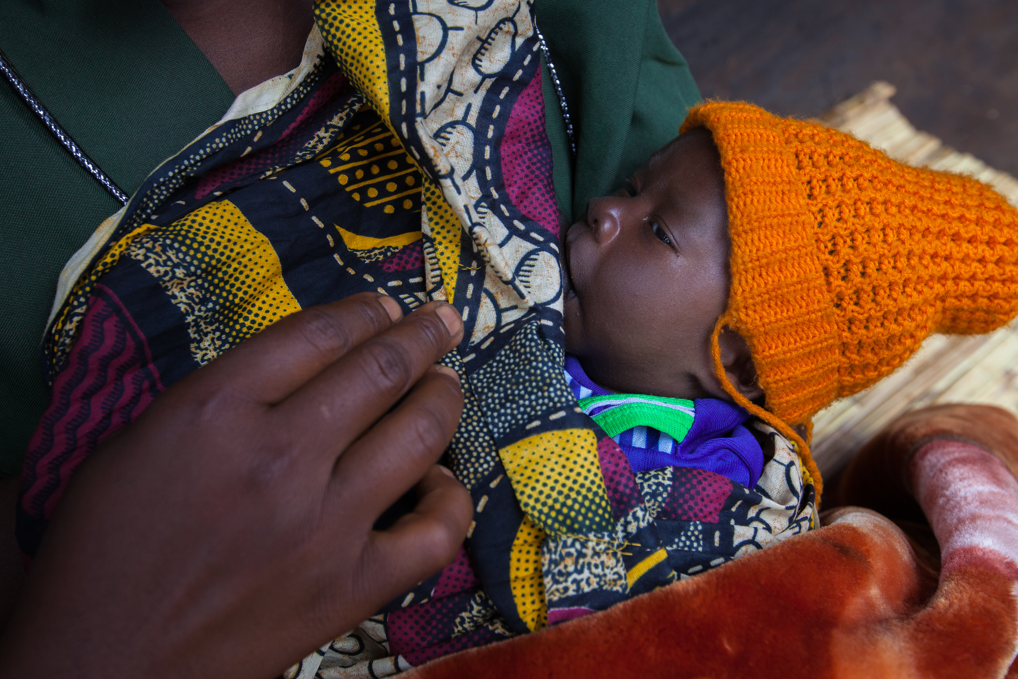 Baby breastfeeding in Malawi. (Courtesy of Guido Dingemans/Jhpiego)
