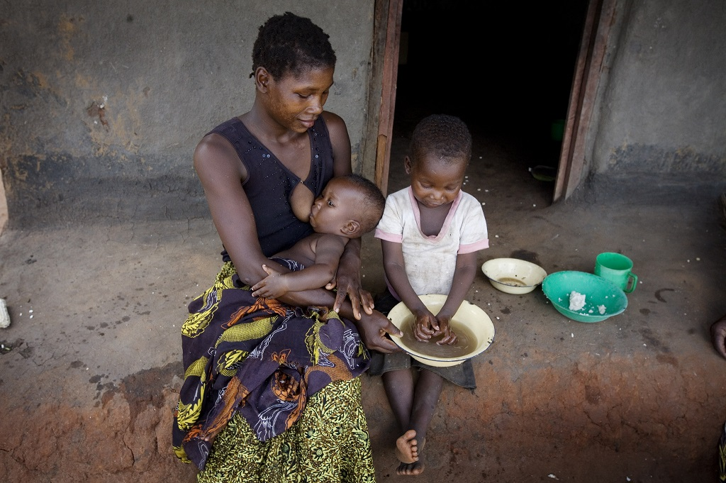 Mother and children at home in Tanzania.