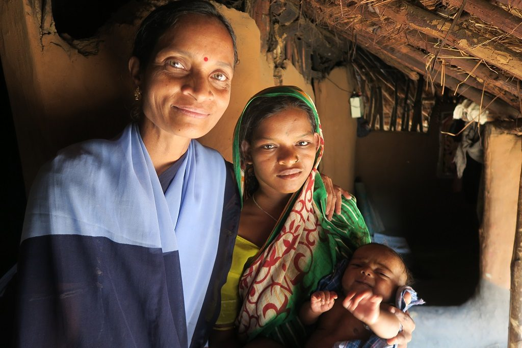 Community health worker Jayanti Laguhuri, at left, with new mother Geetanjali Dehuri at Geetanjali's home
