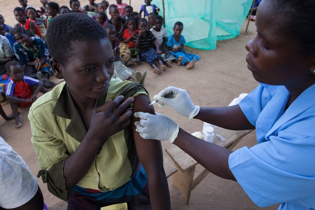 Woman in Malawi receives an immunization