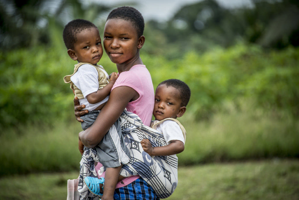 A mother with her children in Ghana.