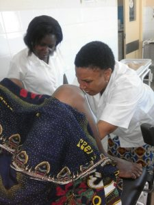 Above: Fátima Cobre assisting a woman in labor at Nacala Porto District Hospital.