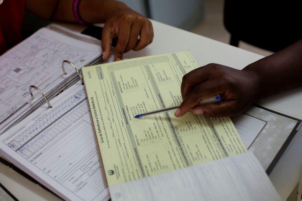 Mozambican nurses doing paperwork.