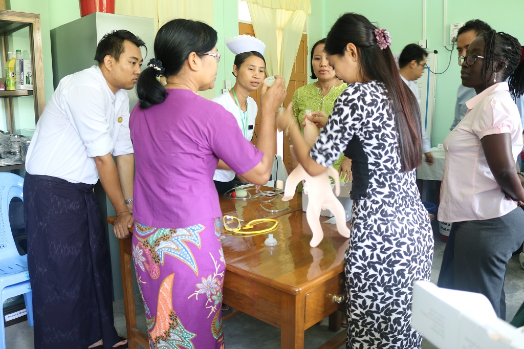 A skills lab management team practices how to assemble the simulation models during a Skills Lab Coordinator Workshop at Pathein L&PIC, Ayeyarwady Region.