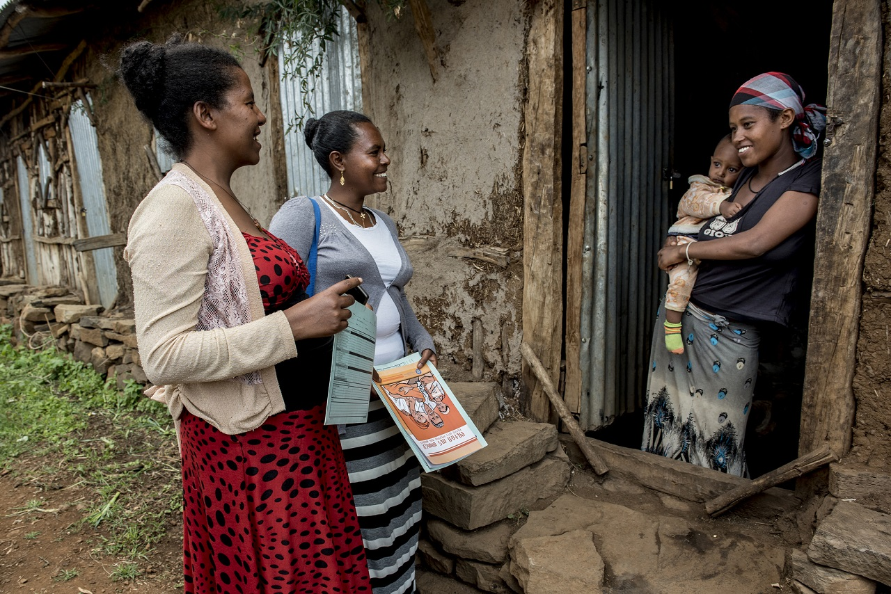 Health Extension Worker Misaye Asmamaw visits Addis Yaregal, a mother, at home.