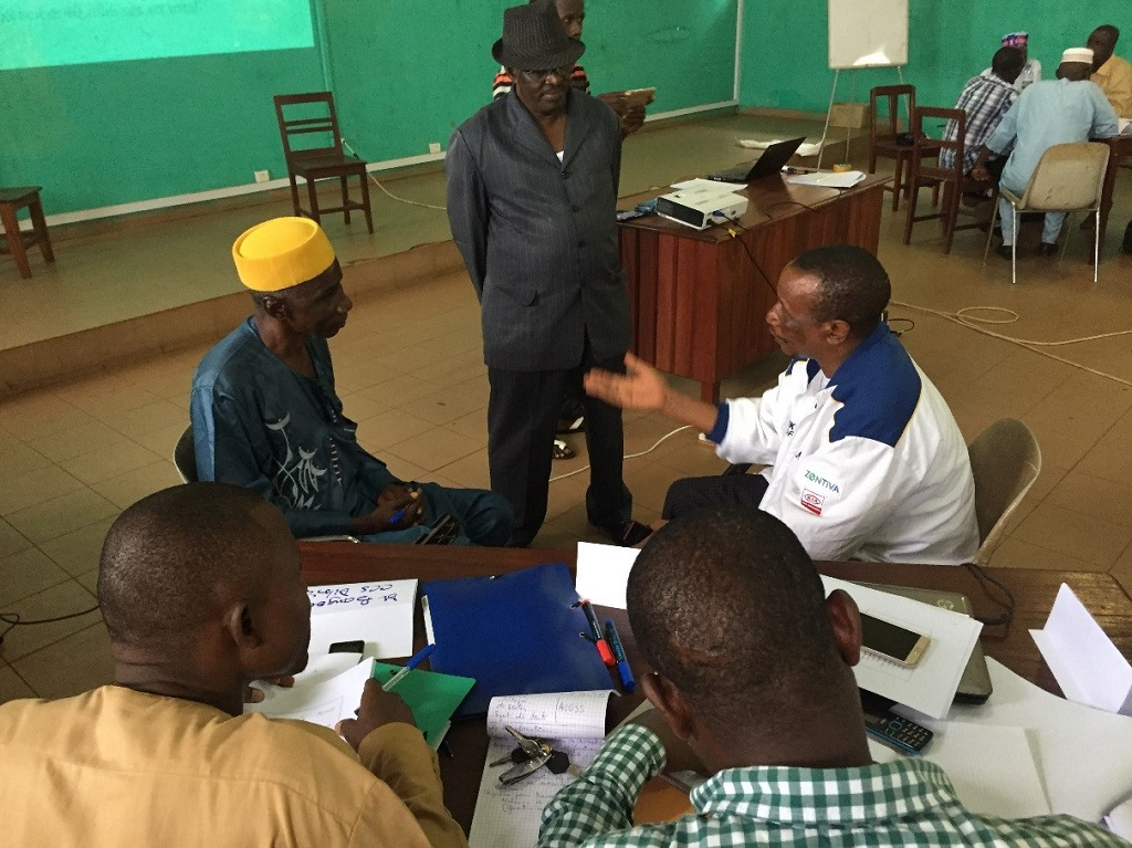 Members of the Boké district health management team role play to practice using effective communication techniques during the regional training on resource mobilization and stakeholder coordination.