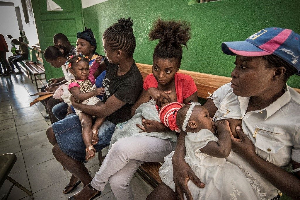 Women with children waiting for care in Marmalade, Haiti.