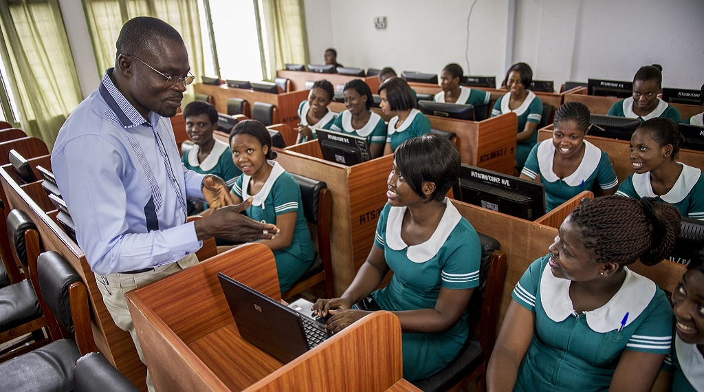 Midwifery students in Hohoe, Ghana, listen to their instructor.