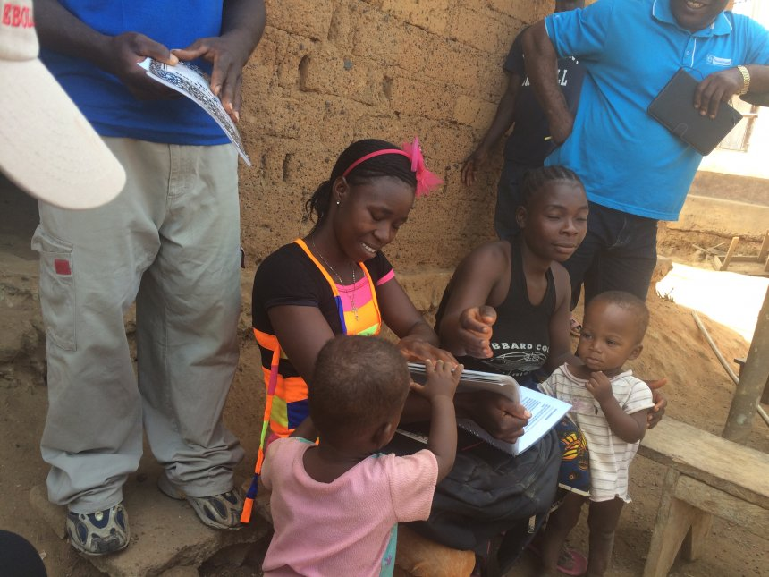 Female Community Health Volunteer interacting with a mother and her under-five children in Nimba County, Liberia