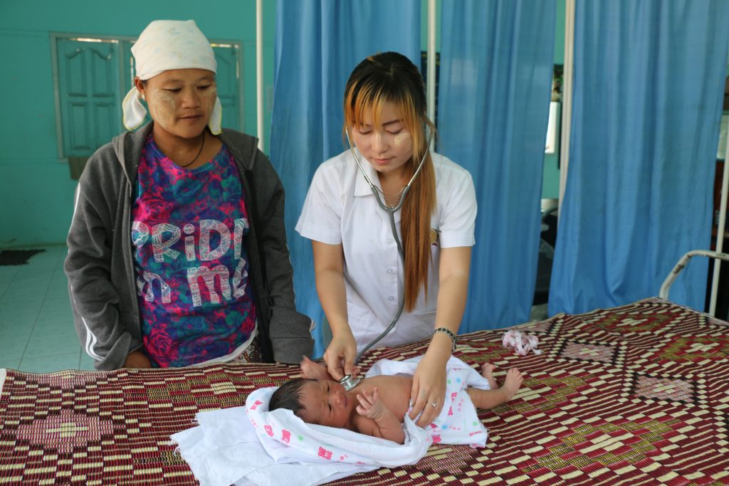 Midwife Naw Eh Paw Htoo examines a baby