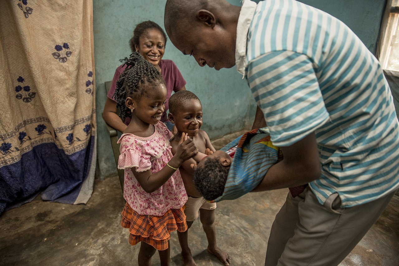 Nwafor Monica and her husband, Israel, with their three children in their home