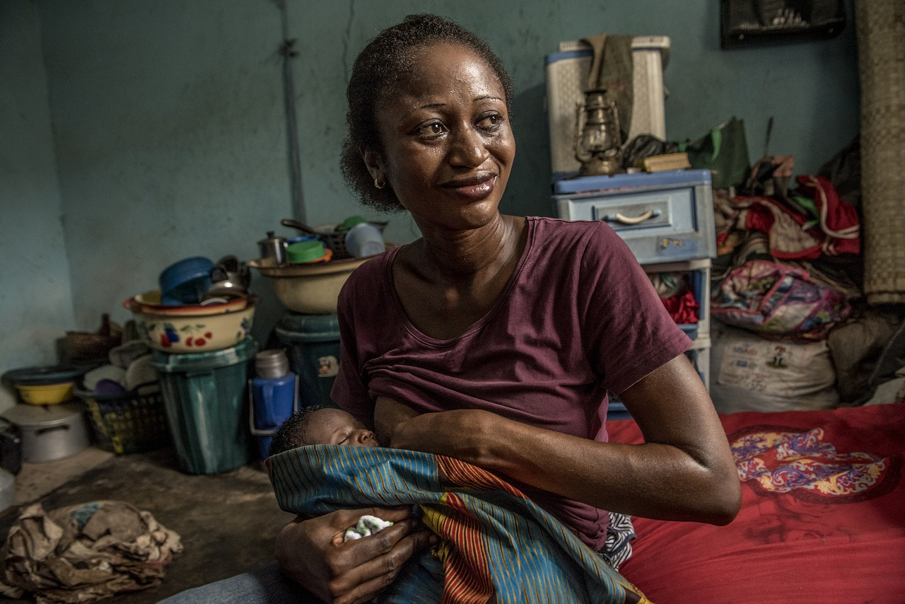Nwafor Monica breastfeeds her newborn at home.